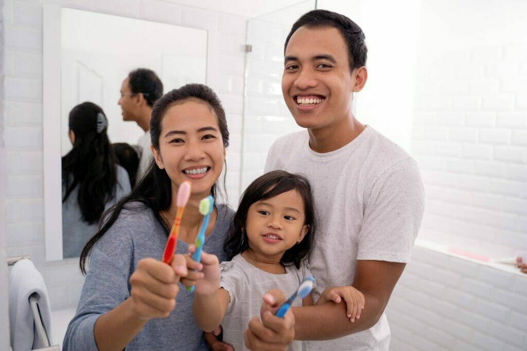 kitchener dentist brushing teeth with family